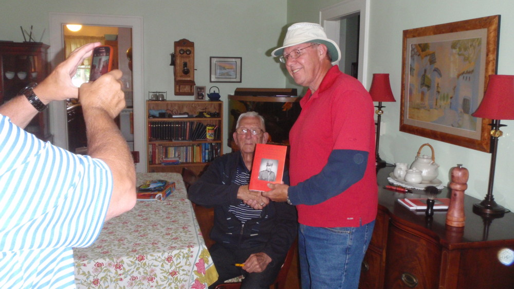 Doug receives an autographed copy of Nelson Craig's memoirs.