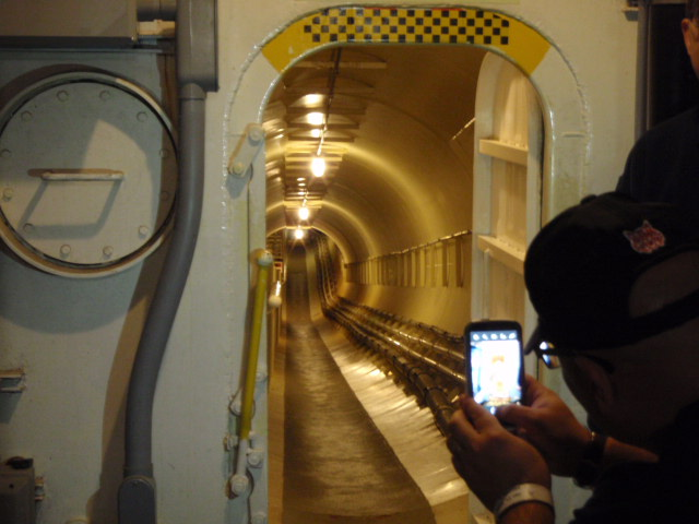 Service tunnel beneath the facility.  Utilities and climate control are remarkable even today.